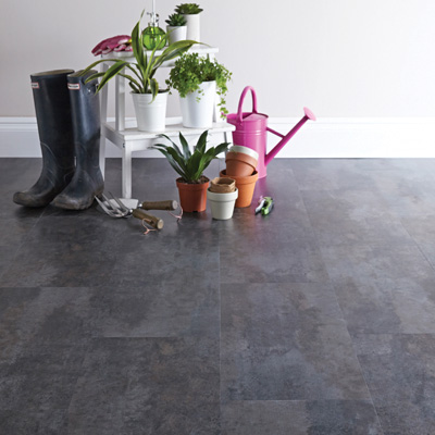 Lifestyle Floors Colosseum Weathered Slate in room with plants and Wellington boots